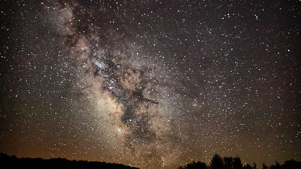 The Milky Way Stole Some of Its Outer Stars from Another Galaxy
