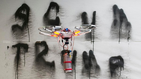 Watch a Drone Programmed to Spray Anti-Trump Graffiti