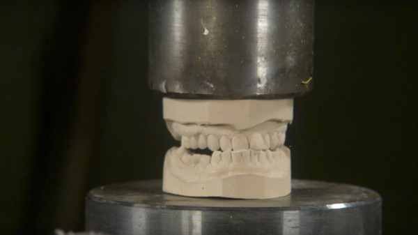 Watch Fake Teeth Get Smashed to Bits by the Hydraulic Press