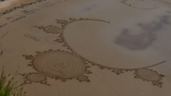 The Pleasure of Watching Massive Fractals Get Drawn on a Beach with a Rake