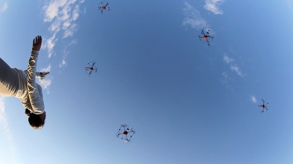 Dances with Drones: When a Flock of UAVs Joins a Human Dancer