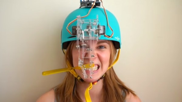 This Inventor Made a Robotic Toothbrushing Helmet, So We Asked Her: Wait, Why?