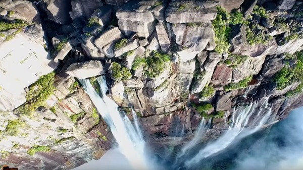 Watch a Drone Take You Over the Edge of the World's Highest Waterfall