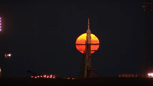 The Supermoon Rising Behind a Russian Rocket Is Awe-Inspiring