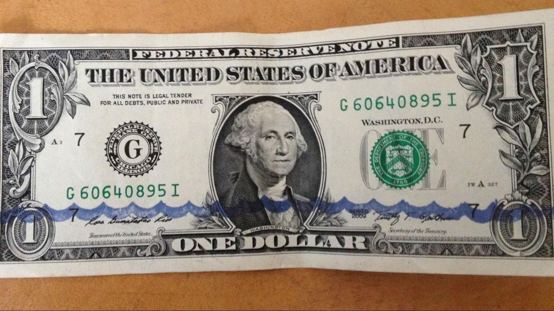 People Are Stamping Rising Sea Levels onto Dollar Bills for Climate Change