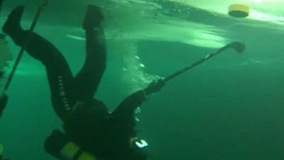 Russian Divers Play Hockey Upside Down on the Underside of a Frozen Lake