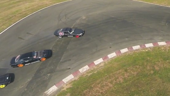 Watch a Drone Crash In the Middle of a Car Race, Get Smashed to Bits