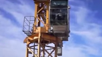 Annoyed Crane Worker Appropriately Shows His Butt to Pesky Drone