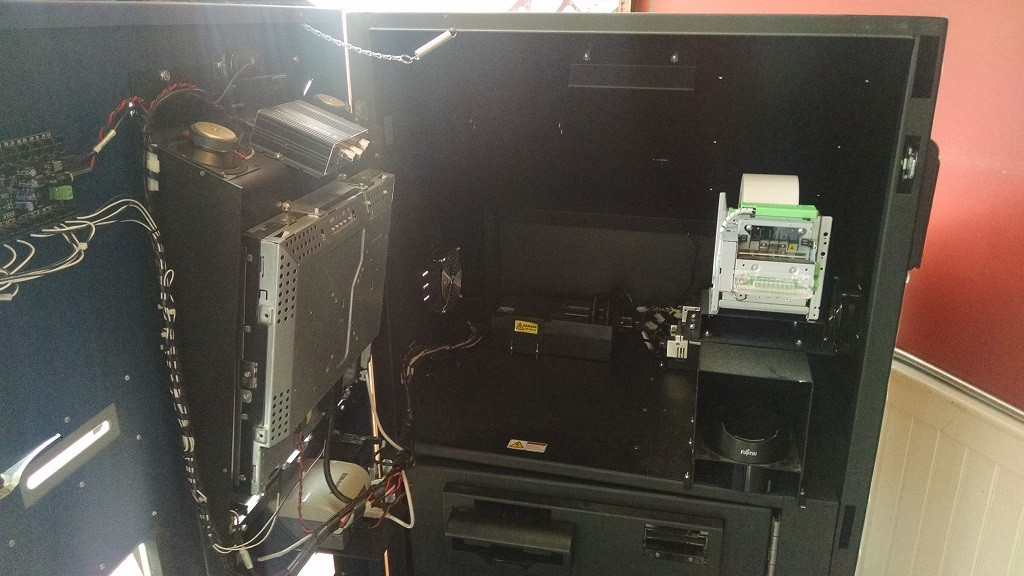 Why Is This Bitcoin ATM Decomposing in a Burger Joint?