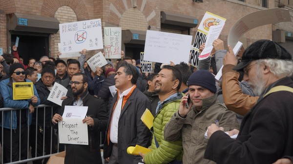 Uber Drivers Rally in Front of NYC Headquarters Over Price Drop