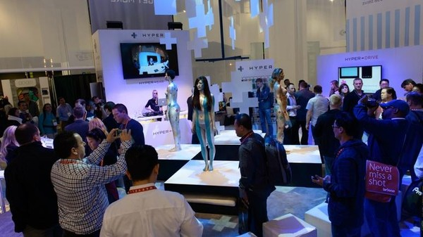 Letter from CES: Want to Get People into Your Phone Charger Booth? Bring Naked Painted Women (NSFW)