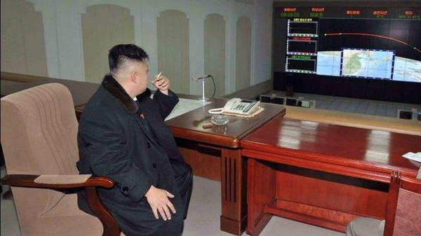 Kim Jong-un Photographed Watching His Rocket Launch While in Flavor Country